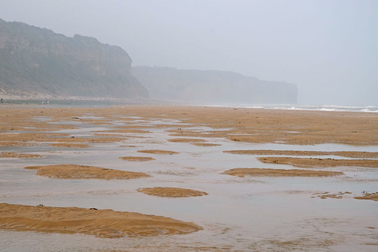 1944 6 June American Landing Sector Beach Courage D Day Honnor Roll  Landing Looking West Mist Normandie France Omaha Beach Tide