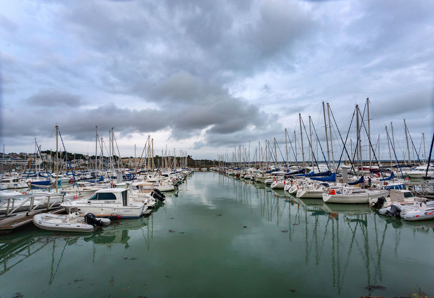 Beauty In Nature Cloud - Sky Day Harbor Marina Mast Mode Of Transport Moored Nature Nautical Vessel No People Outdoors Reflection Sailboat Scenics Sea Sky Tranquility Transportation Water Yacht