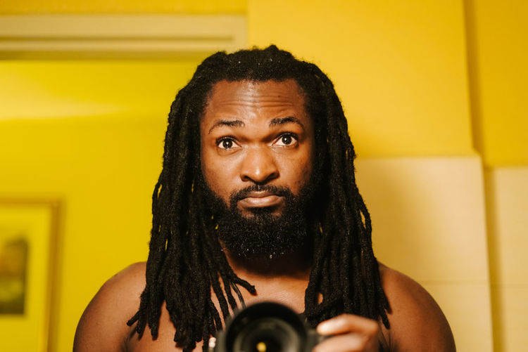 Self Mood. Portrait One Person Headshot Front View Indoors  Looking At Camera Yellow Hair Real People Lifestyles Holding Young Adult Adult Black Hair Hairstyle Dreadlocks Standing
