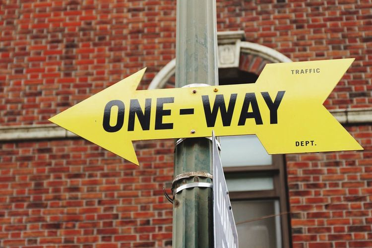 Low Angle View Of One Way Sign On Pole