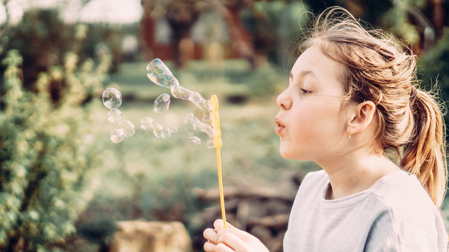 Portrait of girl looking at bubbles