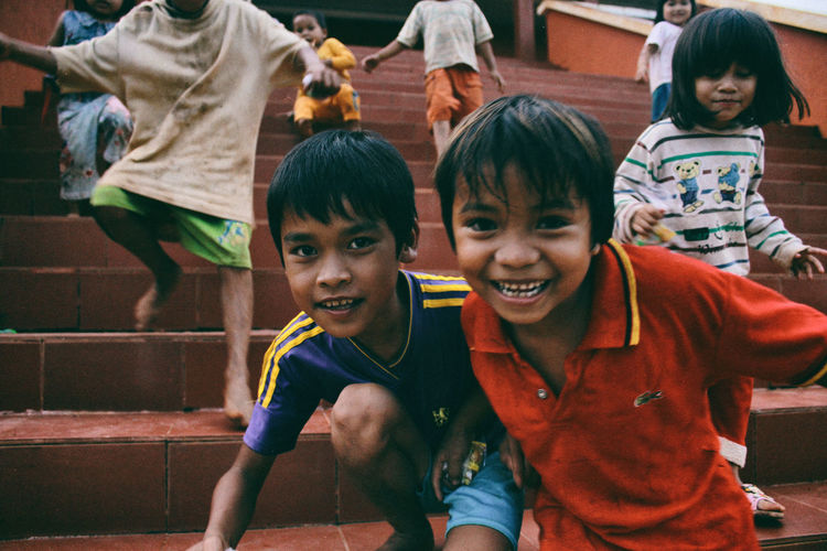 Happiness of poor children on highlands. Children Happiness Happy Life Bonding Boys Child Childhood Close-up Day Enjoyment Friendship Fun Happiness Lifestyles Looking At Camera Mouth Open Outdoors People Poor Children Portrait Portrait Of Children Real People Smiling Togetherness