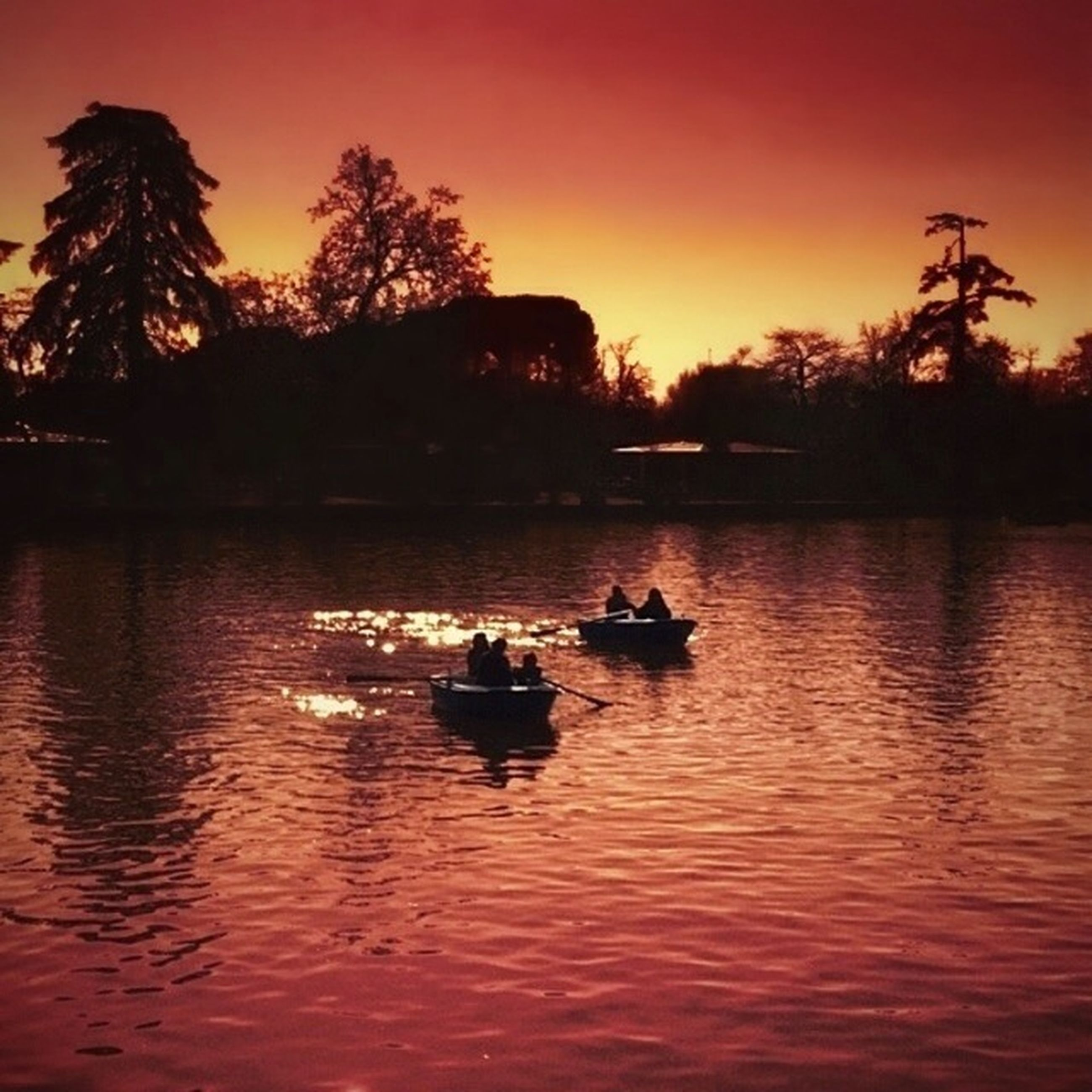 sunset, nautical vessel, transportation, water, silhouette, mode of transport, boat, tree, orange color, waterfront, reflection, tranquil scene, scenics, sky, lake, tranquility, beauty in nature, nature, rippled