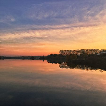 Sunset Sky Scenics Tranquility Nature Tranquil Scene Reflection Beauty In Nature Cloud - Sky Orange Color Outdoors No People Water Silhouette Lake Travel Destinations Tree Day
