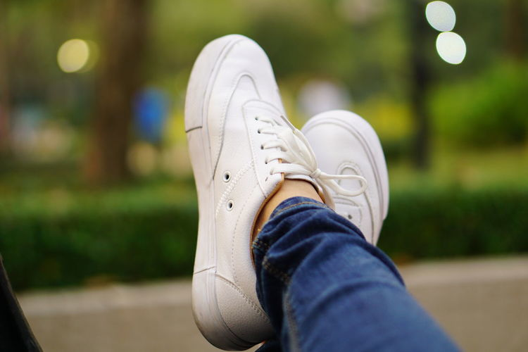 Low section of woman wearing shoes outdoors