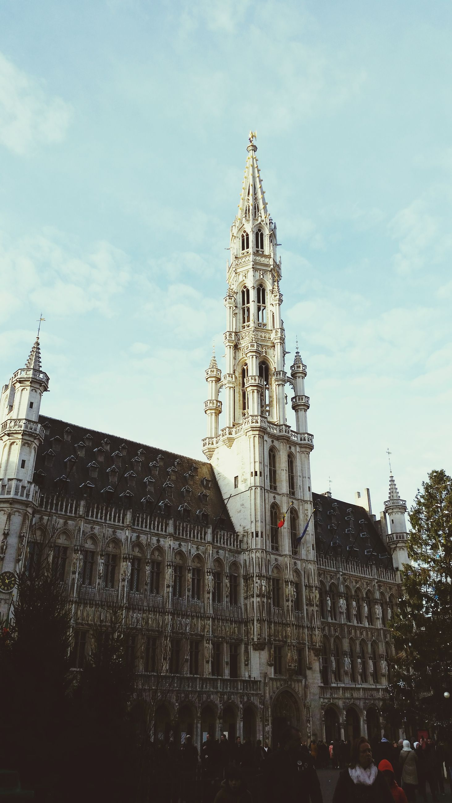 architecture, building exterior, built structure, religion, church, place of worship, spirituality, cathedral, low angle view, sky, tower, famous place, travel destinations, clock tower, city, tall - high, steeple, tourism