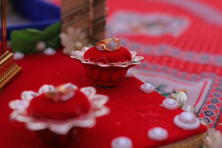 High angle view of red rose on table