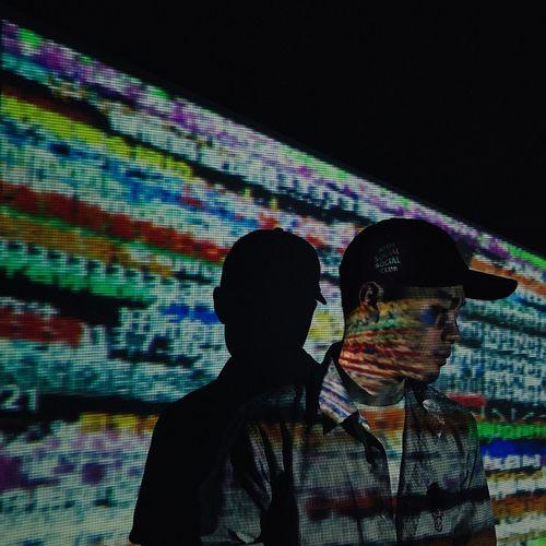 Close-up of man using smart phone at night