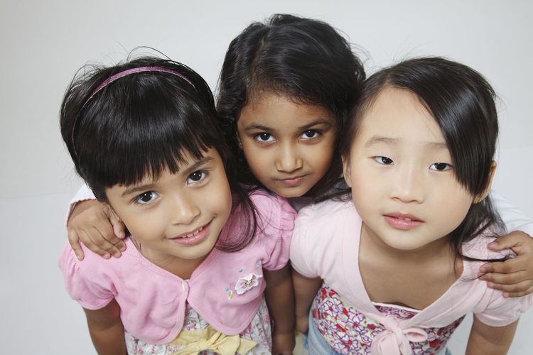 malaysia girls chinese,indian and male ethnicity having fun together Fun Happiness Indian Innocence Bff Bonding Child Childhood Chinese Elementary Age Females Girls Group Of People Harmony High Angle View Joy Looking At Camera Malay Malaysia Playful Portrait Smiling Studio Shot Three People Togetherness