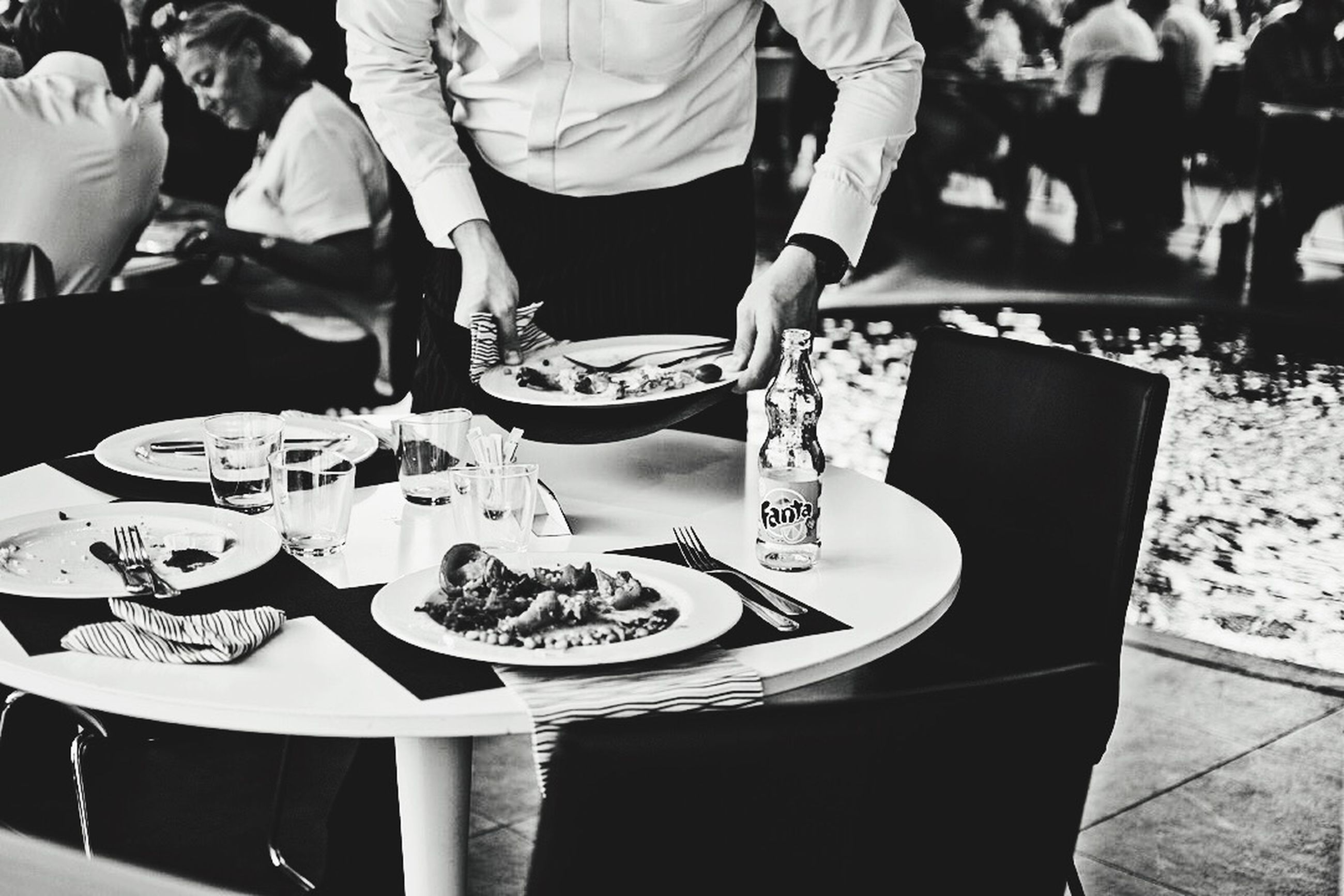 men, person, lifestyles, leisure activity, indoors, table, incidental people, large group of people, restaurant, midsection, standing, low section, casual clothing, focus on foreground, high angle view, sitting