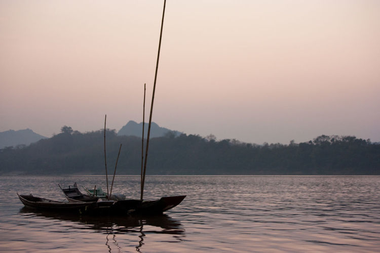 Boat on Mekong river - Laos Laos Boat River Sunset Mountain Mekong Mekong River