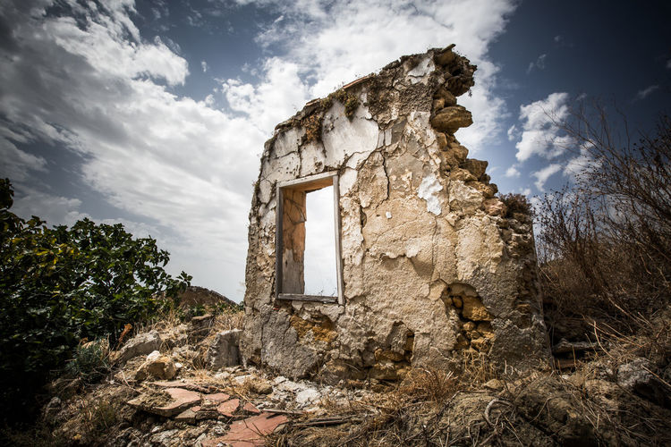Demolished House Against Cloudy Sky