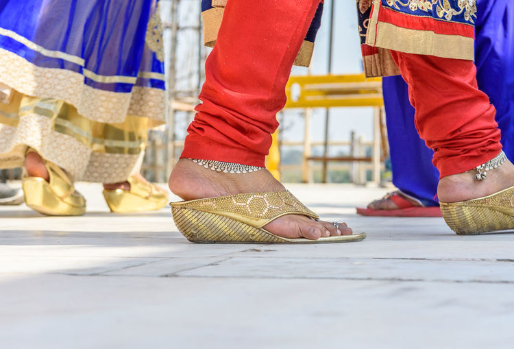Low section of woman wearing anklets