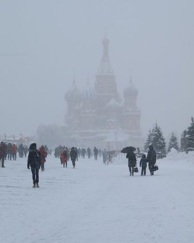 St Basil's Cathedral shrouded in fog Winter Snow Cold Temperature Travel Destinations Tourism Weather Travel Built Structure Real People Outdoors Large Group Of People Leisure Activity Vacations People History Lifestyles Nature Full Length Architecture Snowing
