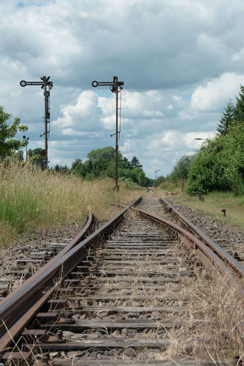 lost railway junction Junction Lost Switch Cloud - Sky Empty Grass Nature No People Old Rail Transportation Railroad Track Railway Signal Sky The Way Forward Train - Vehicle Transportation Tree Unused