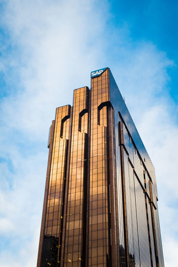 golden sap sky scraper in auckland against the blue sky Auckland Travel Architecture Blue Building Building Exterior Built Structure City Cloud - Sky Day Glass - Material Low Angle View Minimal Modern New Zealand No People Office Office Building Exterior Outdoors Reflection Sky Skyscraper Sunlight Tall - High The Architect - 2018 EyeEm Awards