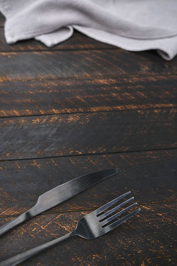 Decorated cutlery, fork and knife on a blue napkin. mockup