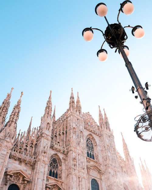 Duomo Milan Architecture Built Structure Clear Sky Day Direct Light Duomo Di Milano Illuminated Low Angle View No People Outdoors Religion Sky Spirituality Stories From The City