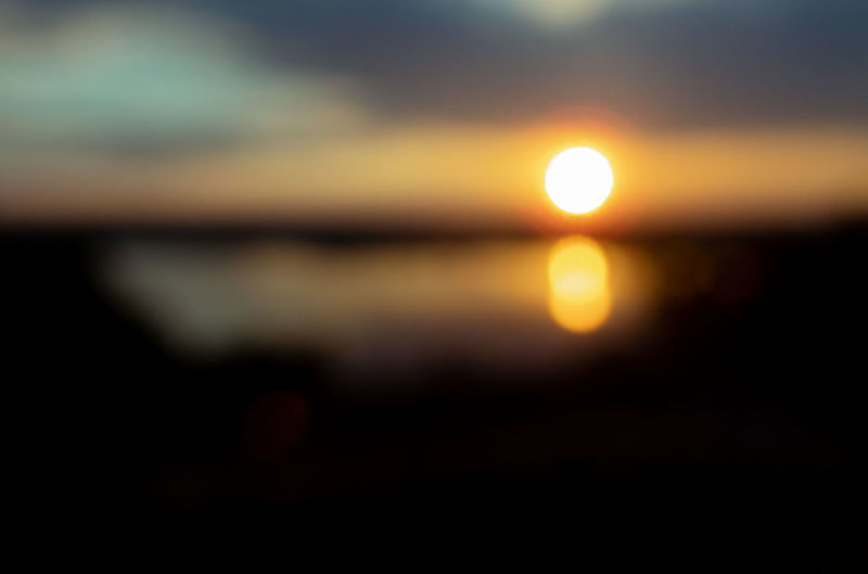 Beauty In Nature Circle Defocused Land Lens Flare Nature No People Orange Color Outdoors Reflection Scenics - Nature Silhouette Sky Sun Sunset Tranquil Scene Tranquility Water The Great Outdoors - 2018 EyeEm Awards Summer Road Tripping
