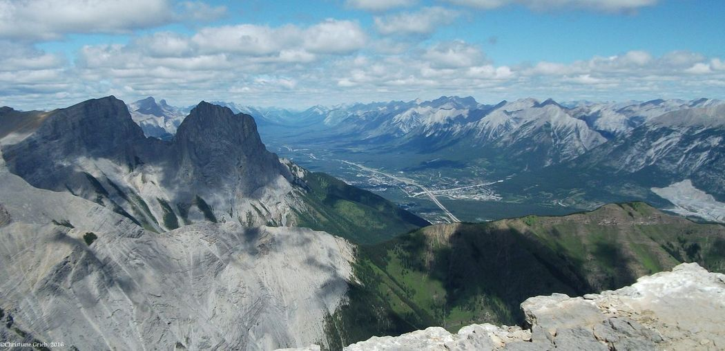 View of the Three Sisters and Bow Valley from Windtower Mountain, Alberta. Bow Valley Bow Valley View Canadian Rockies  Canmore Alberta Canada Mountaineering Three Sisters Blue Mountains Three Sisters Mountain Canmore Alberta View From Windtower Mountain, Alberta Beauty In Nature Cloud - Sky Go Higher High Above The Mountains Mountain Peak Mountain Range Outdoors Rock Tranquility Valley View The Great Outdoors - 2018 EyeEm Awards
