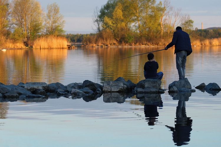 Real People Rear View Water Togetherness Reflection Family With One Child Full Length Nature Childhood Father Lake Beauty In Nature Standing