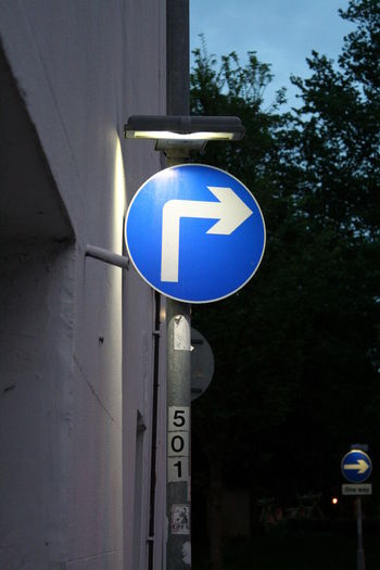 Blue Close-up Directional Sign Guidance Illuminated Information Information Sign No People One Way Sign Outdoors Pole Right Turn Only Road Sign Sign Sky