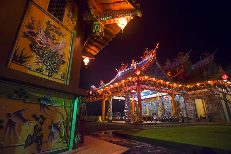 Benoa, Bali, Indonesia - January 28, 2017 : People praying and wishing a happy chinese new year on vihara satya dharma. Architecture Art And Craft Belief Building Building Exterior Built Structure Decoration Illuminated Lighting Equipment Low Angle View Nature Night No People Ornate Outdoors Place Of Worship Religion Sky Spirituality Travel Destinations