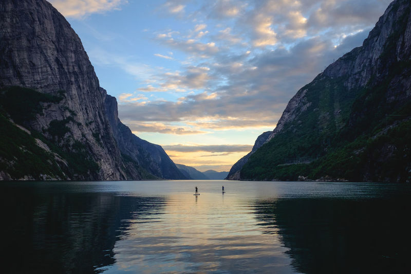 Scenic View Of Fjord By Mountains Against Sky