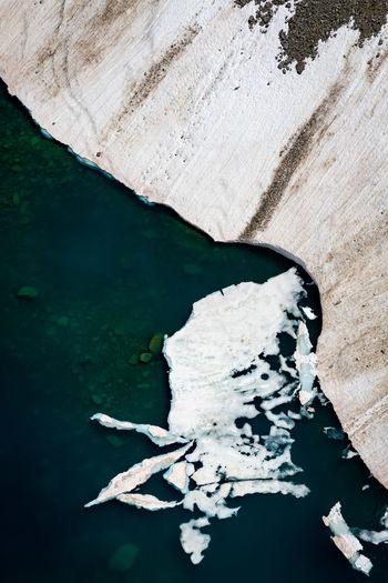 Aerial view of glacier by sea
