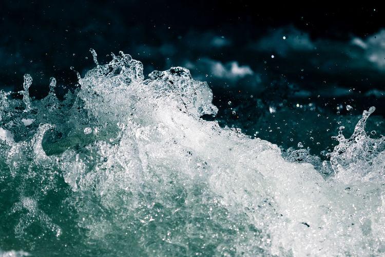 Close-up of wave splashing on sea