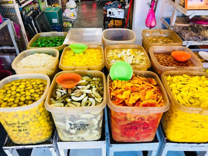 Fruit pickle sold at Chow Rasta Market Penang Malaysia . Locals named them 'jerky' Jeruk Fruits Pickle Variation Food For Sale Choice Retail  Food And Drink Market Abundance High Angle View Market Stall Multi Colored Freshness Large Group Of Objects No People