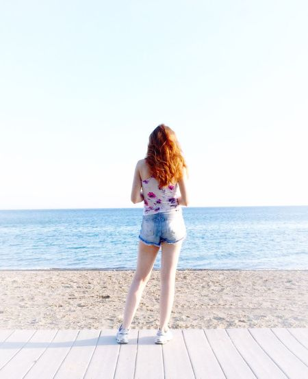 Horizon Over Water Full Length Lake Ontario Sneakers Red Hair Jean Cut Offs Water Clear Sky Copy Space Leisure Activity Casual Clothing Summer Young Women Day Person Nature Vacations Tranquility Tranquil Scene Standing Lifestyles Outdoors Cloud - Sky Beauty In Nature Young Adult Scenics