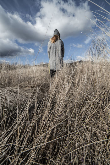 Woman in a dry wheat field with eyes covered with a gray cap Afraid Alone Autumn Fear Field Freedom Grass Nature Romantic Travel Trekking Wheat Woman Cap Countryside Covered Eyes Female Girl Landscape Mountains Relaxation Solitude Vacation Wind