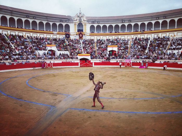 Bullfighter Architecture Built Structure Building Exterior Full Length Tourism Famous Place Travel Destinations In Front Of Outdoors Person Tourist Day Casual Clothing Arch Architectural Column History The Past