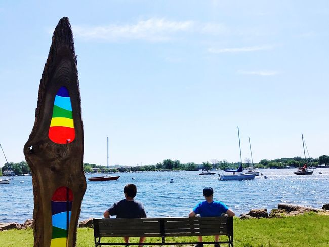 Water Day Sea Flag Sky Rear View Nautical Vessel Nature Patriotism Outdoors Men Sitting Real People Beauty In Nature People