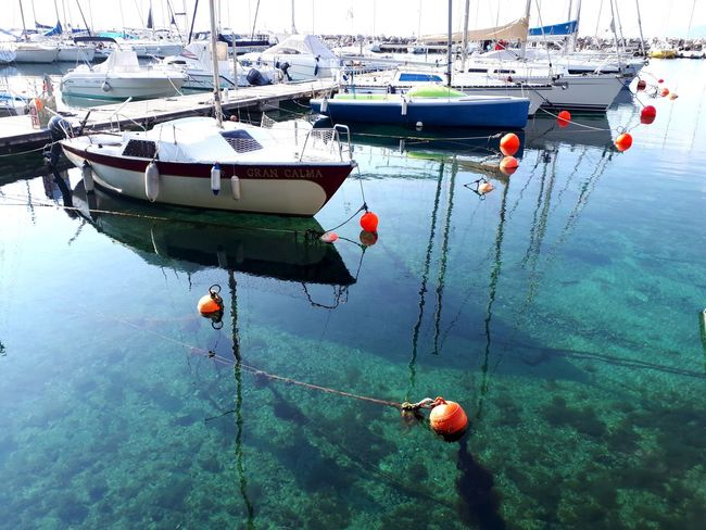 Emerald Sea Emerald Water Water Nautical Vessel Moored Buoy Reflection High Angle View Sky Close-up Float Harbor Boat Sailing Boat Marina Water Vehicle Floating On Water