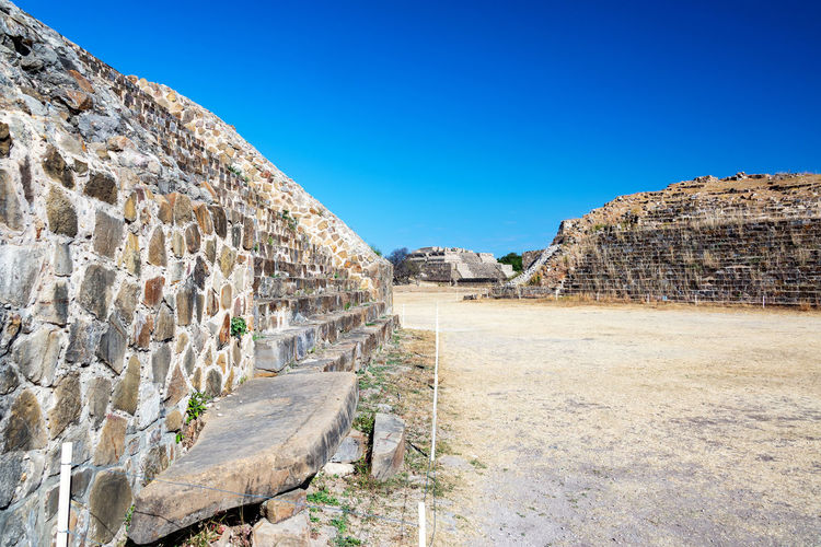 Beautiful blue sky and ancient temples in Monte Alban in Oaxaca, Mexico Ancient Archeology Architecture Cityscape Hills Mayan Mayan Ruins Mexico Oaxaca Oaxaca México  Pyramid Ruins Temples Travel Civilization Culture Maya Monte Alban Mountain Platform Ruin Stone Stones Temple Tourism