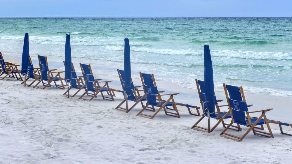 Waiting Chairs. Beach Sea Sand Chair Outdoor Chair Horizon Over Water Relaxation Vacations Water Nature Summer Sunbathing Tranquility Tranquil Scene Beauty In Nature No People Day Scenics Sand Dune Outdoors