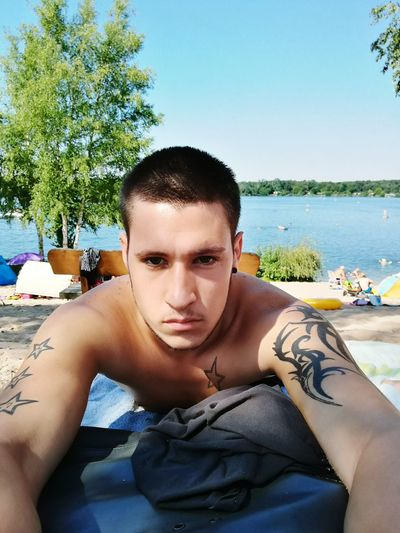 Portrait Swimming Pool Looking At Camera Relaxation Young Adult One Person Outdoors Sky Social Issues Adults Only Tree Day Leisure Activity Adult People Water Shirtless Only Men One Man Only
