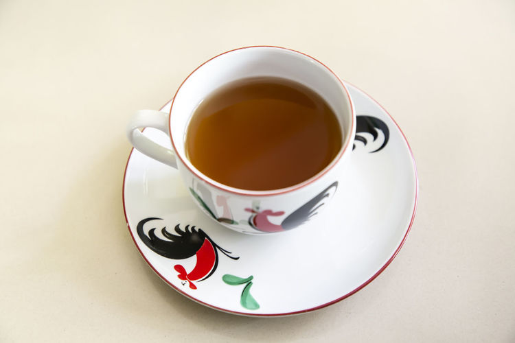 Coffee Coffee - Drink Coffee Cup Crockery Cup Drink Food And Drink Freshness High Angle View Hot Drink Indoors  Mug No People Non-alcoholic Beverage Refreshment Saucer Spoon Still Life Table Tea Tea - Hot Drink Tea Cup