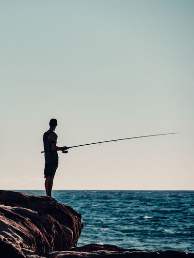 Man fishing silhouette