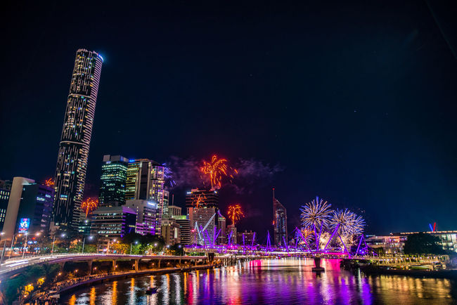 Architecture Bridge - Man Made Structure Brisbane Building Exterior Built Structure City Cityscape Fireworks Illuminated Midnight Modern Neon Night No People Outdoors River River Fire River View Riverside Sky Skyscraper Travel Destinations Urban Skyline Water Waterfront