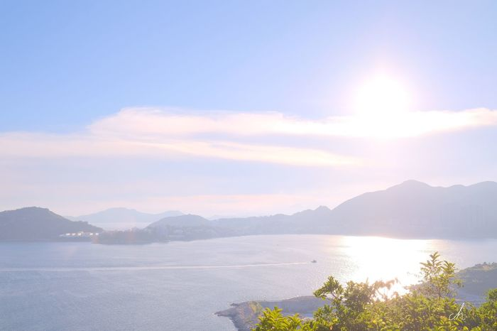Mountain Tranquil Scene Water Scenics Tranquility Beauty In Nature Sun Mountain Range Sunbeam Sky Majestic Tourism Idyllic Cloud - Sky Nature Travel Destinations Lens Flare Non-urban Scene Remote Sea HongKong Fujifilm Xpro2