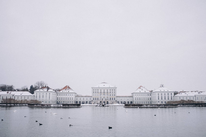Nymphenburg Palace in winter, Munich, Bavaria, Germany. Bavaria Copy Space Horizontal Munich Nymphenburg Palace Tourist Attraction  Travel Photography Winter Architecture Building Exterior Built Structure Clear Sky Day Europe Germany Landmark Nature No People Outdoors River Schloss Nymphenburg Sky Snow Symmetry Transportation Travel Destinations Water Waterfront