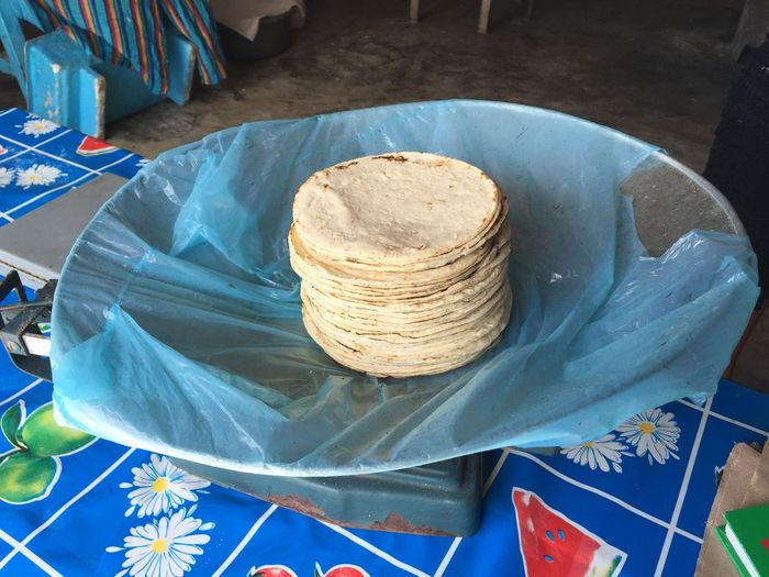 Close-up of fresh baked rotis on weighing scale