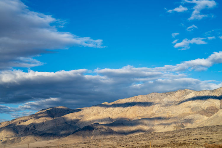 Cloud - Sky Sky Scenics - Nature Beauty In Nature Tranquil Scene Tranquility Blue No People Mountain Non-urban Scene Nature Environment Day Landscape Idyllic Remote Outdoors Land Climate Arid Climate Sierra Shadows Hills Desert Landscape California