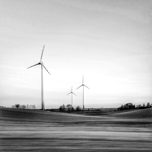 View from train in motion Alternative Energy Clear Sky Electricity  Environmental Conservation EyeEm Best Shots EyeEm Nature Lover Field Fuel And Power Generation Landscape Nature No People Outdoors Photography In Motion Renewable Energy Rural Scene Sky Technology Tranquil Scene Wind Power Wind Turbine Windmill EyeEm Ready