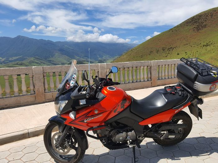 Motor scooter on mountain against sky