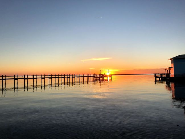 River Pier Sunset Sea Tranquility Tranquil Scene Scenics Water Beauty In Nature Silhouette Outdoors Horizon Over Water Sky Nature Idyllic Reflection Clear Sky Sun No People Built Structure
