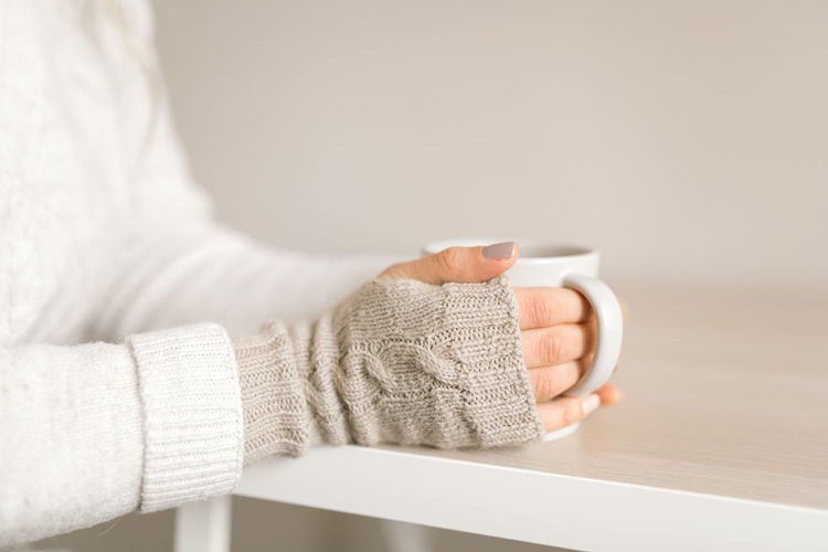 Midsection of woman holding table